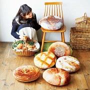 株式会社フェリシモの取り扱い商品「実りの森 おうちはパン屋さん こっそり円座なパンクッション」の画像